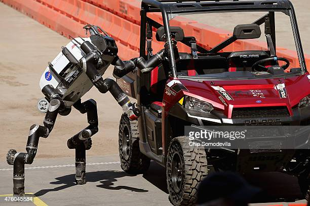 The Jet Propulsion Labs' Team RoboSimian 275pound robot climbs out of a Polaris vehicle after driving through obsticles during the Defense Advanced...