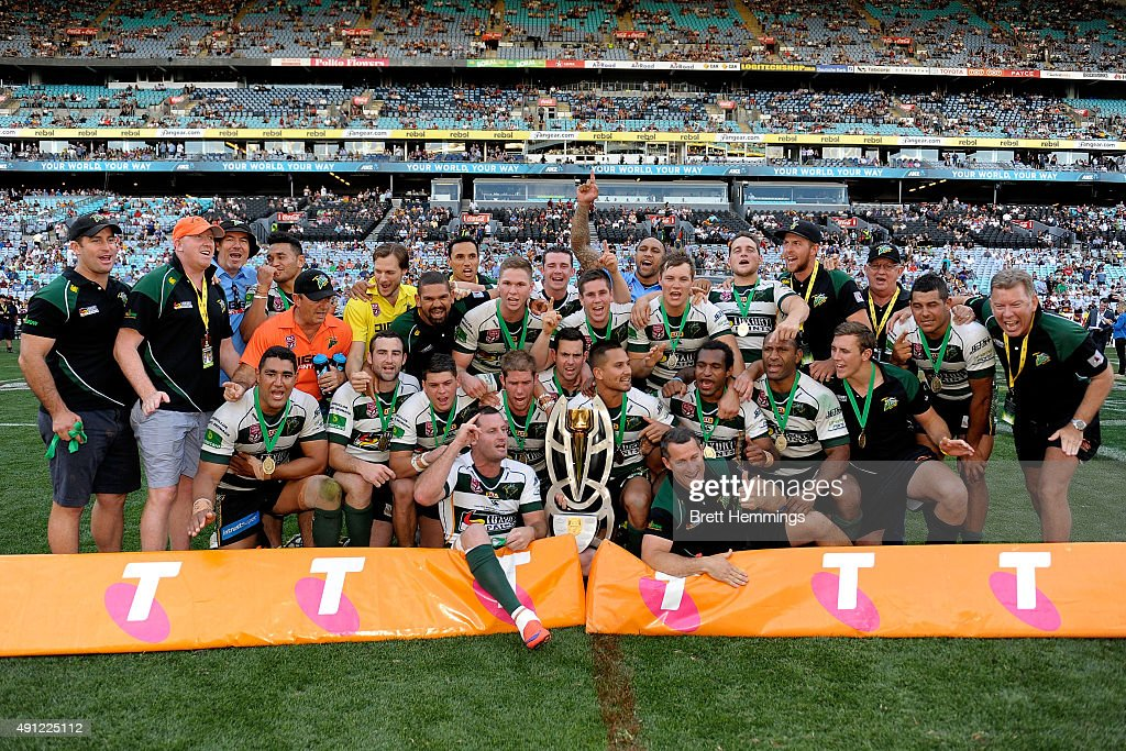 The Jets celebrate with the winners trophy after the 2015 State Championship Grand Final match between Ipswich Jets and the Newcastle Knights at ANZ Stadium on October 4, 2015 in Sydney, Australia.