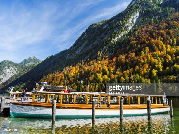 The jetty of St Bartholomae with excursion boats at lake Koenigssee NP Berchtesgaden Europe Central Europe Germany Bavaria october