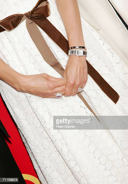 The jewelry of actress Ashley Judd are seen as she arrives at the Cartier And Interview Magazine 'Celebrate Love' party at the Cartier Mansion June 8...