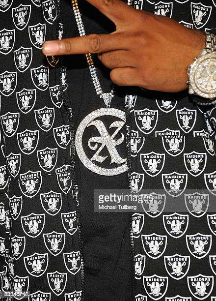 The jewelry of hiphop artist Xzibit is seen at the benefit grand opening of celebrity vehicle customization shop Galpin Auto Sports on October 18...