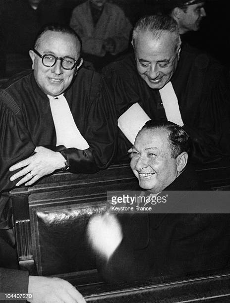 The Jewish Bessarabian scrap merchant Joseph JOANOVICI smiling between his lawayers in 1949 while on trial for having collaborated with the Nazis...