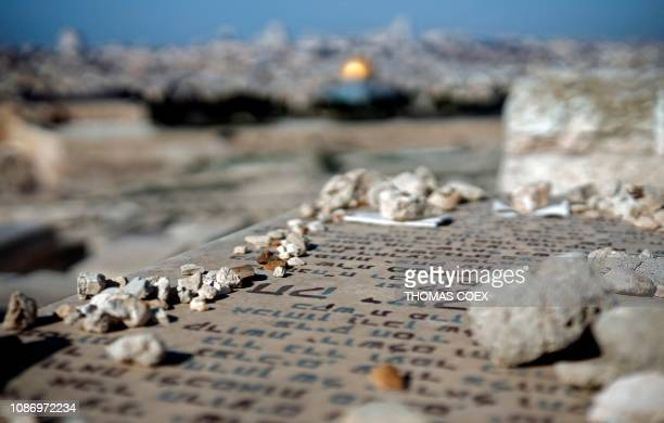 TOPSHOT The Jewish cemetary of Mount of Olives across Jerusalem's Old City is pictured on January 23 2019