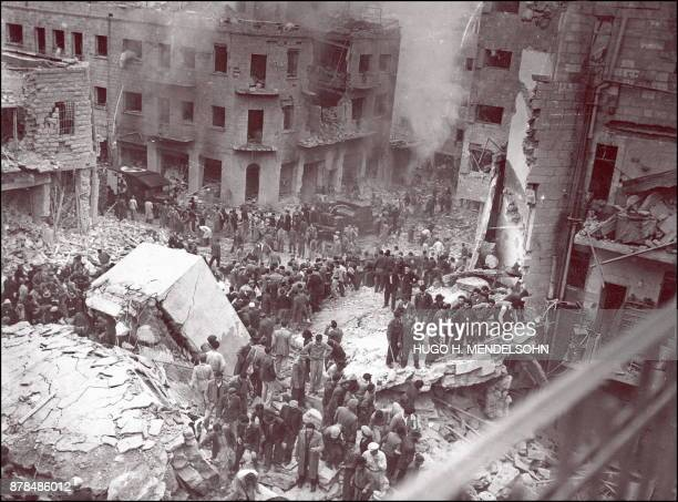 The Jewish rescuers search victims among the rubble of the destroyed buildings Ben Yehuda Street in downtown Jerusalem 02 February 1948 at the...