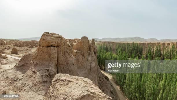 The Jiaohe Ancient Ruins along greenery river valley,China