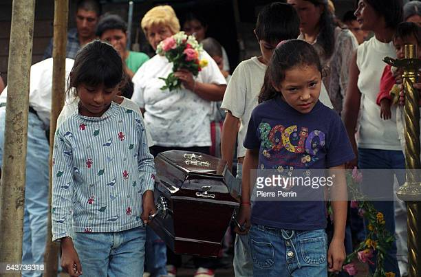 The Jimenez family and their friends attend the funeral of 1monthold Juan Angel His death symbolizes the suffering of childhood by malnutrition and...