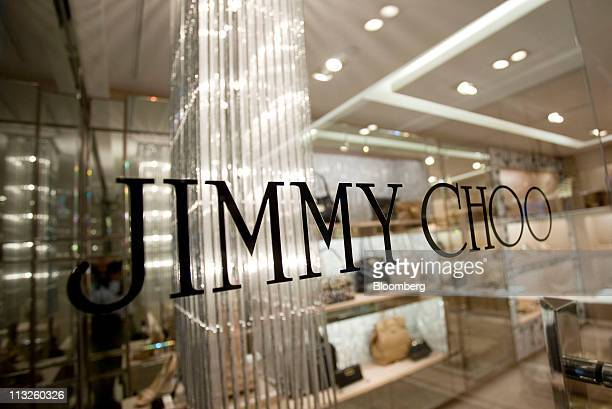 441d8767a71 The Jimmy Choo Ltd logo is displayed on the window of a retail store in Hong