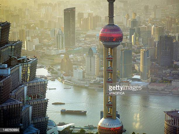 the jin mao tower and oriental pearl tower - oriental pearl tower shanghai stock pictures, royalty-free photos & images