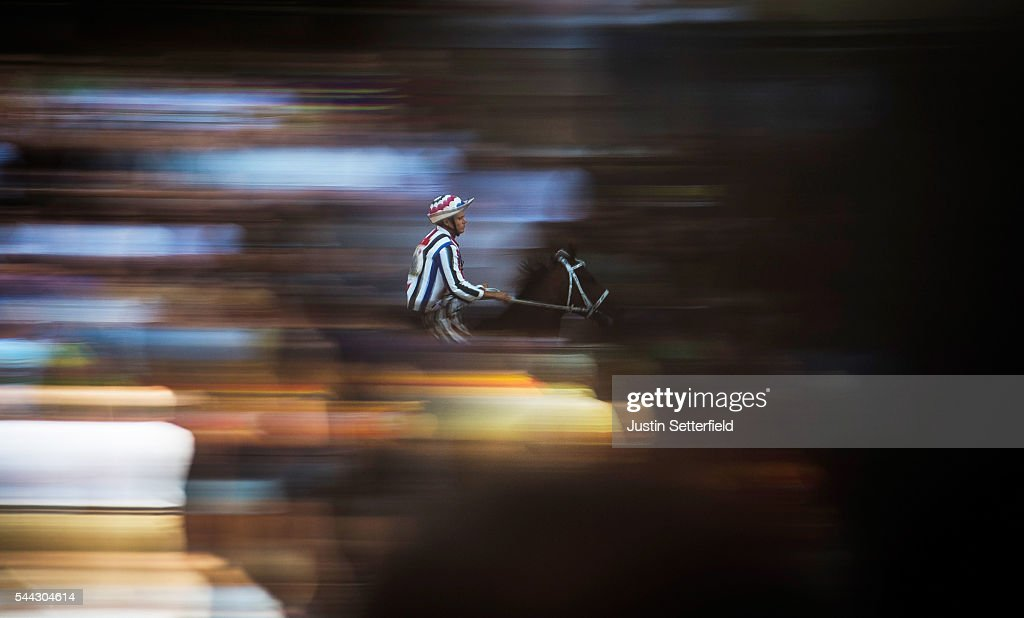 The jockey of the 'Contrada of Istrice' during a trial race of the historical Italian horse race of the Palio Di Siena on June 30, 2016 in Siena, Italy. The Palio di Siena, known locally simply as Il Palio, is a horse race that is held twice each year on 2 July and 16 August, in Siena, Italy. Ten horses representing ten of the seventeen districts 'Contradas' with jockeys 'Fantini' riding bareback compete during a three lap race around a makeshift course built in the 'Piazza del Campo' the city's central square to win the Palio banner. The Palio di Siena is more than a simple horse race. It is the culmination of ongoing rivalry and competition between the contrade. The lead-up and the day of the race are invested with passion and pride. The Palio held on 2 July is named Palio di Provenzano, in honour of the Madonna of Provenzano, a Marian devotion particular to Siena which developed around an icon from the Terzo Camollia. The race winner is awarded a banner of painted silk, or palio, which is hand-painted by a different artist for each race.