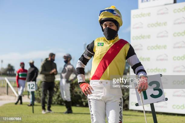 The jockey Robert Cornell waits for the race keeping the social distance during competition day as Uruguay slowly returns to normal due to...