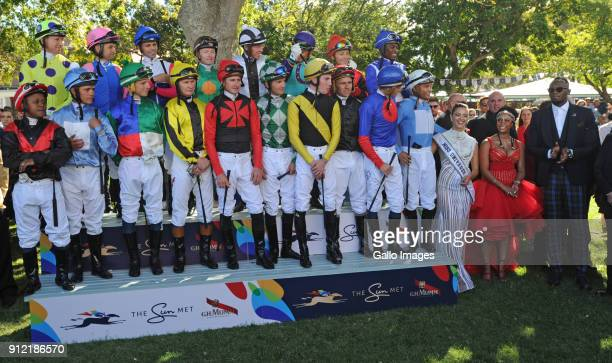 The Jockeys for the main race and Usain Bolt during the 2018 Sun Met at Kenilworth Racecourse on January 27 2018 in Cape Town South Africa The 134th...