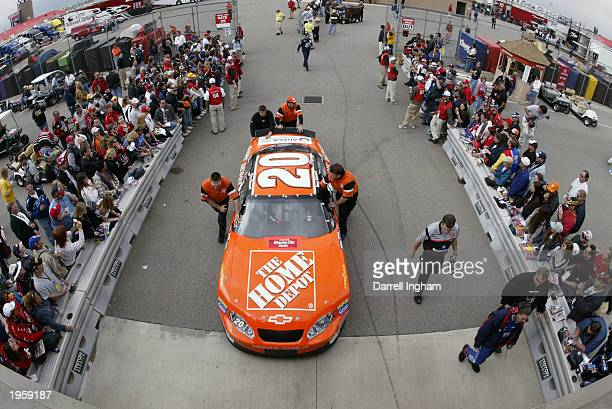 The Joe Gibbs Racing Home Depot Chevrolet of Tony Stewart is rolled out for qualifying for the NASCAR Winston Cup AUTO CLUB 500 on April 25 2003 at...