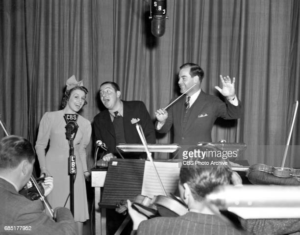 The Joe Penner Show CBS Radio comedy program Featuring left to right vocalist Julie Gibson host Joe Penner and orchestra leader Jimmy Grier Image...