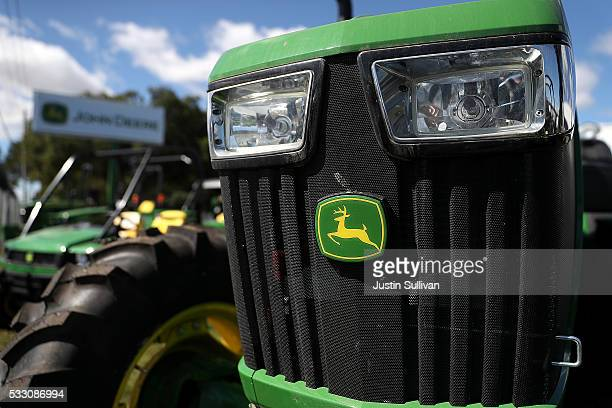 The John Deere logo is displayed on a tractor at Belkorp Ag on May 20 2016 in Santa Rosa California Illinois based Deere Co reported a 2825 percent...