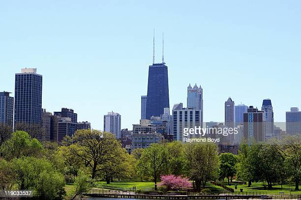 The John Hancock Center towers over other buildings as shot looking South from a bridge at Lincoln Park Zoo in Chicago Illinois on May 16 2011