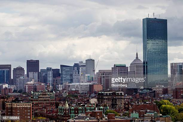 The John Hancock Tower right stands in the city skyline in Boston Massachusetts US on Tuesday Oct 7 2014 Boston ranked fifth among US cities in the...