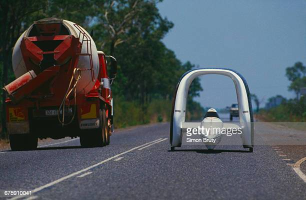 The John Paul Mitchell solarpowered car designed by Jonathan Tennyson drives on Stuart Highway during the inaugural Darwin to Adelaide Pentax World...