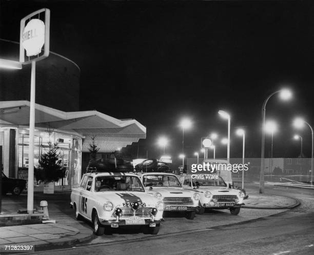 The John Willment Racing Team Ford Cortina GT team prepare for the Monte Carlo Rally from a Shell petrol station on 16 January 1964 at Twickenham...