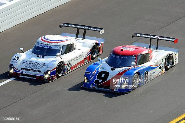 The Johnnie Walker Ford Riley driven by Zak Brown Mark Patterson Mark Blundell and Martin Brundle drives side b side with the Action Express Racing...