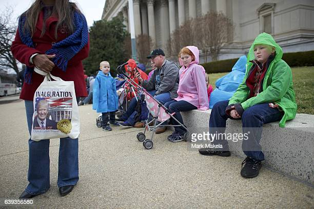 The Johnson family comprising 10 children aged 115 and their parents from Tucson AZ sit on a wall after the inauguration of Donald Trump as the 45th...