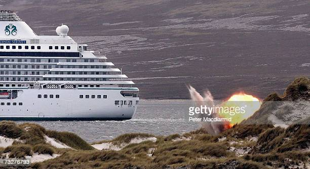 The Joint Service Explosive Ordnance Disposal unit detonate a Spanish made antivehicle mine in sight of a cruise ship on February 9 2007 in Stanley...