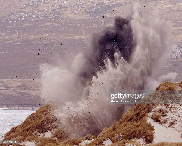 The Joint Service Explosive Ordnance Disposal unit detonates a Spanish made antivehicle mine in a safe area of the sand dunes near Stanley on...