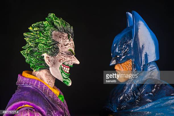 the joker and batman face to face - joker card stock photos and pictures