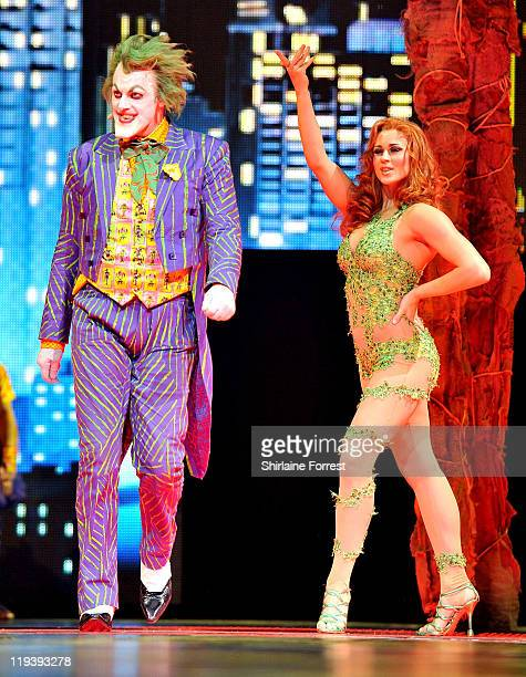 The Joker played by Actor Mark Frost and Poison Ivy played by Actress Valerie Murzak perform on stage at the world premier of 'Batman Live' at...