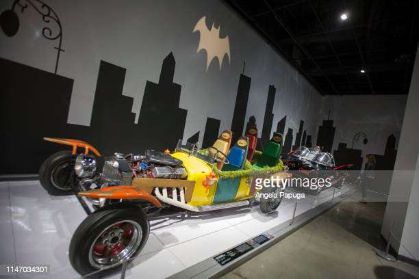 The Jokermobile and Batmobile from the TV series Batman is seen during the opening of the new exhibit Hollywood Dream Machines Vehicles Of Science...