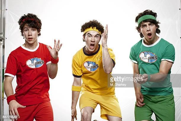 The Jonas Brothers are photographed at the Disney Games in the Epcot Center at Walt Disney World