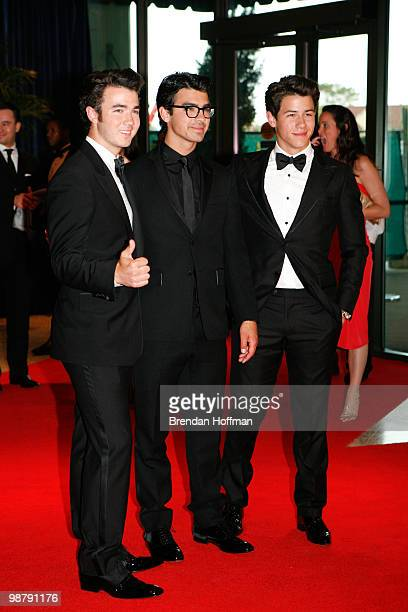 The Jonas Brothers Kevin Joe and Nick arrive at the White House Correspondents' Association dinner on May 1 2010 in Washington DC The annual dinner...