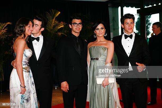 The Jonas Brothers Kevin Jonas with wife Danielle Deleasa Joe Jonas with girlfriend Demi Lovato and Nick Jonas arrive at the White House...
