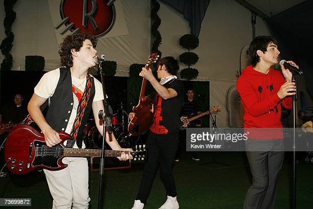 The Jonas Brothers with musicians Nick Kevin and Joe Jonas perform at the after party for the premiere of Disney's 'Meet The Robinsons' at the El...