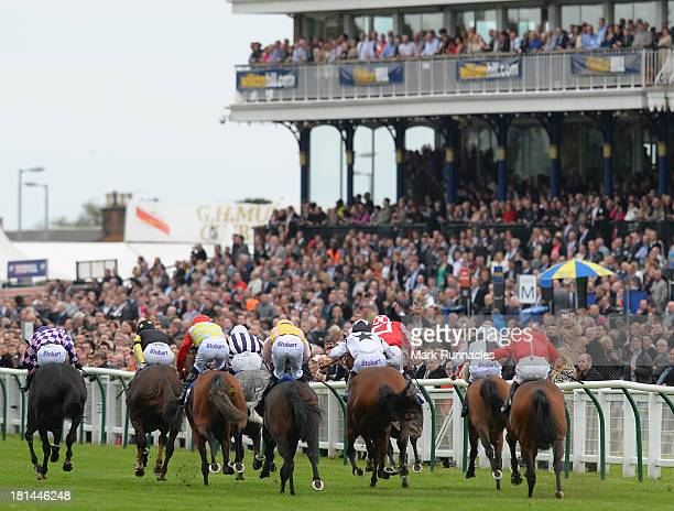 The Jordan Electrics Ltd Handicap Stakes watched by a full grandstand of spectators at Ayr racecourse on September 21 2013 in Ayr Scotland