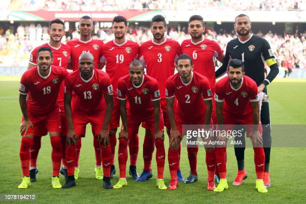 The Jordan players line up for a team photo during the AFC Asian Cup Group B match between Australia and Jordan at Hazza Bin Zayed Stadium on January...