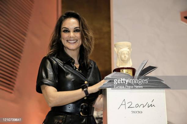 The Journalist Monica Carrillo with her award after winning the Azorín 2020 Prize for her novel 'La vida desnuda' at the Azorín Prize Gala in...