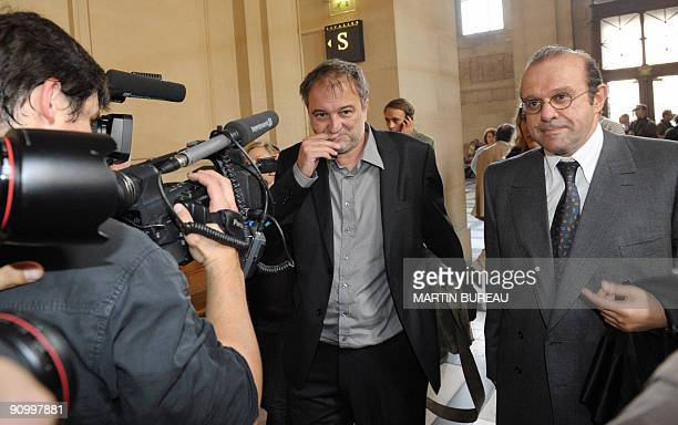 The journalist who broke the story Denis Robert arrives with his lawyer Herve Temime for the opening of the socalled Clearstream affair trial on...