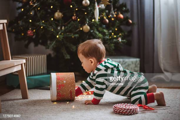 the joy of christmas morning - one baby boy only stock pictures, royalty-free photos & images
