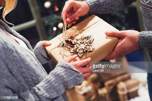 the joy of gift giving at christmastime - christmas present stock pictures, royalty-free photos & images
