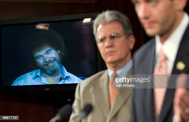 The Joy of Painting host Bob Ross plays in the senate studio while Sen Tom Coburn ROkla left and Rep Paul Ryan RWisc conduct a news conference on...