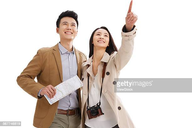 the joy of the young lovers travel - pointing at camera stock photos and pictures