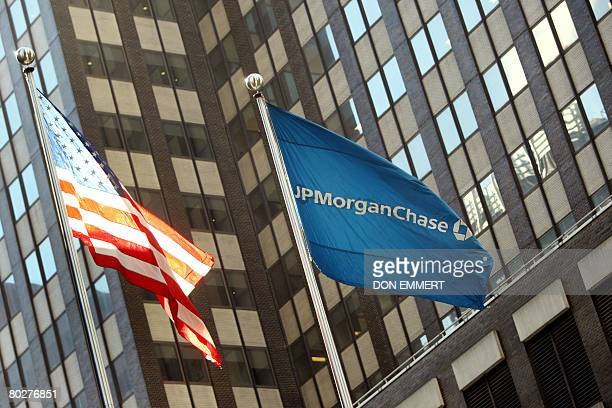The JP Morgan Chase flag flies near its headquarters in New York on March 17 2008 JP Morgan Chase bought Bear Stearns Co for 2 USD a share with help...