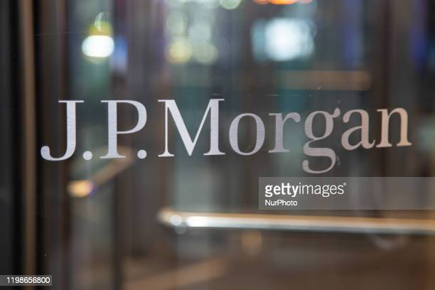 The J.P. Morgan logo sign on the entrance of a glass office building in Midtown Manhattan, New York, USA on 23 January 2020. JPMorgan Chase & Co....