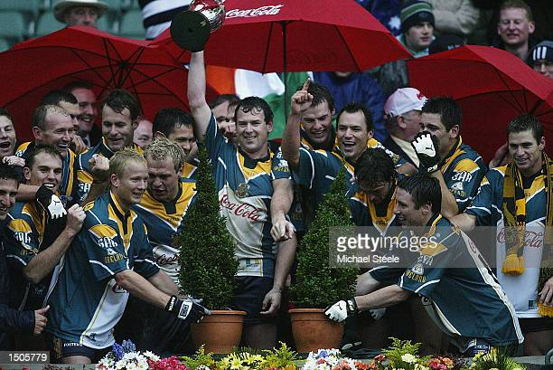 The jubilant Australian team lift the trohy after defeating Ireland in the Ireland v Australia International Rules Series match at Croke Park Dublin...