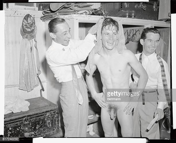 The jubilation of Derby Day extends even to the jockey's dressing room as five time Derby winner Eddie Arcaro who rode fourth place Goyamo kneads the...