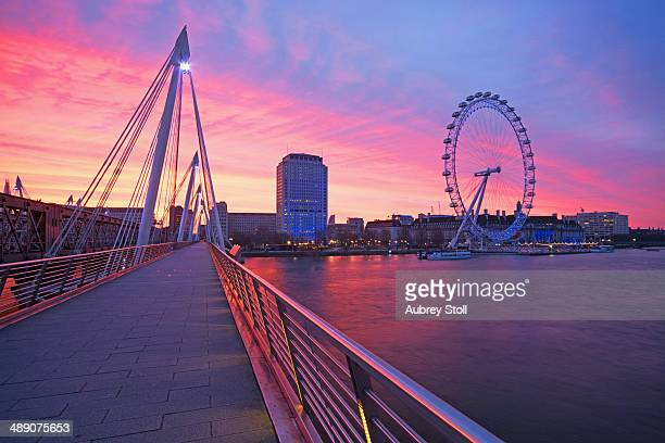 The Jubilee bridge leading to the Millennium bridge on the South Side of the Thames river at sunrise.