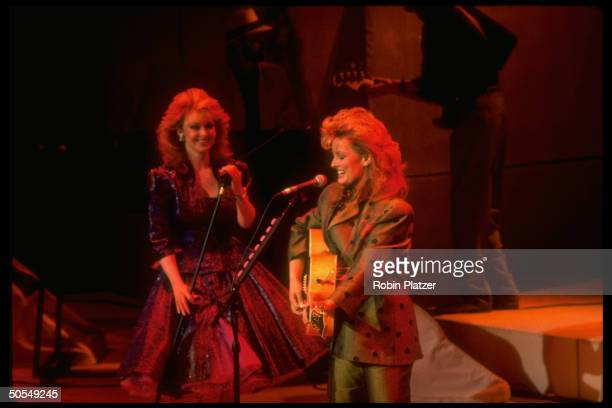 The Judds Naomi and Wynonna performing on stage
