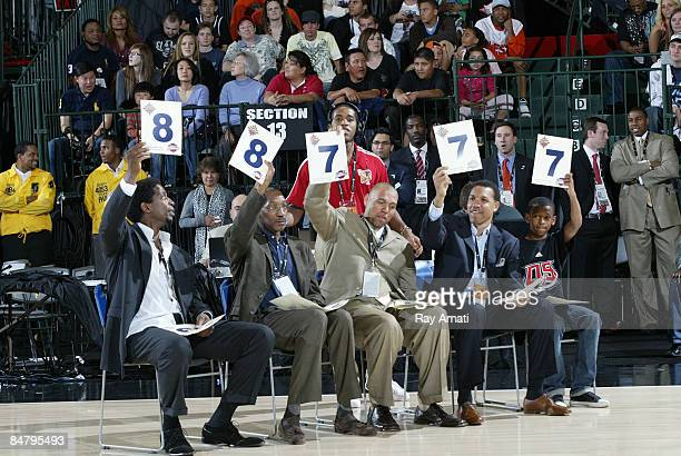 The judges hold up there scorecard during the Slam Dunk Contest as part of the DLeague Dream Factory Skills Competition on center court during NBA...