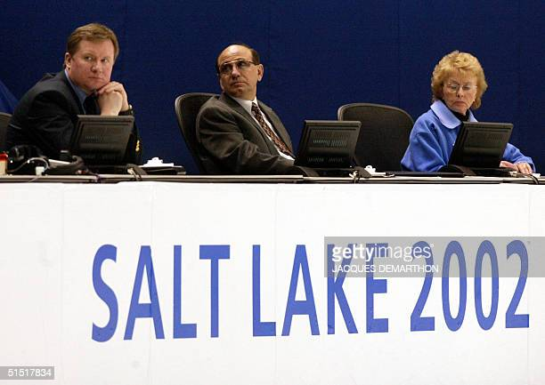 The judges Janet Allen, Nicolae Bellu and Yury Kliushnikov look at the men's free programs at the Olympic Ice Center, 14 Feruary 2002 during the...