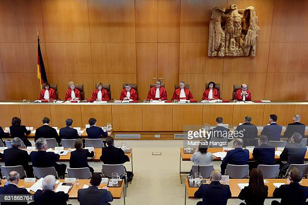 The judges of the Second Senate of Germany's Federal Consitutional Court sit down after precenting the court's verdict not to ban the farright NPD...